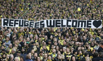 2beff0b400000578-3231929-borussia_dortmund_supporters_pictured_in_2014_hold_a_banner_duri-a-71_1442068715543